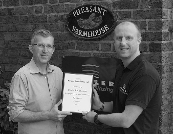 Martin Ravenscroft recieving an award for 15 years of service.