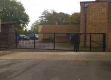 Metal Gate Installation - Waller Building and Glazing